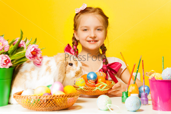 Cute girl with Eastern eggs and cute rabbit