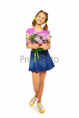 Happy girl holding pail with pink tulips