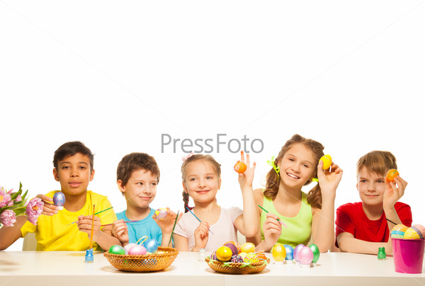 Five funny children with colourful Eastern eggs