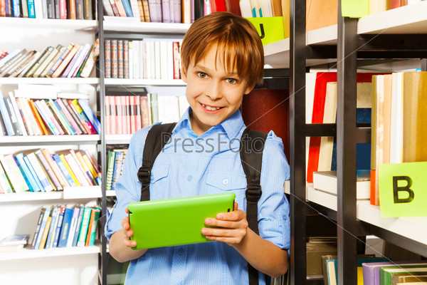 Elementary student with tablet in library