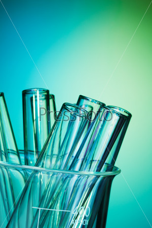 Glass test tubes together on the blue background
