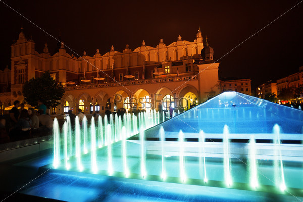 Fountain of Cloth Hall on Rynek Glowny in Krakow