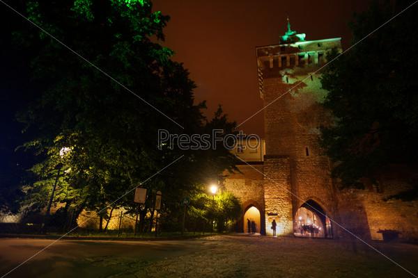 St. Florian's Street gates at night in Krakow