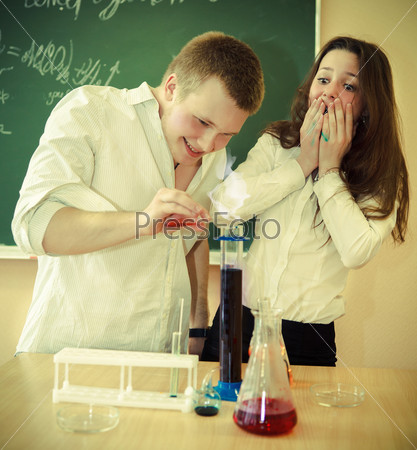 Students working in chemistry laboratory at the classroom