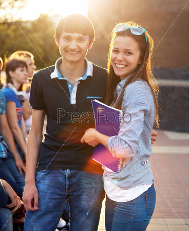 Group of students or teenagers with notebooks