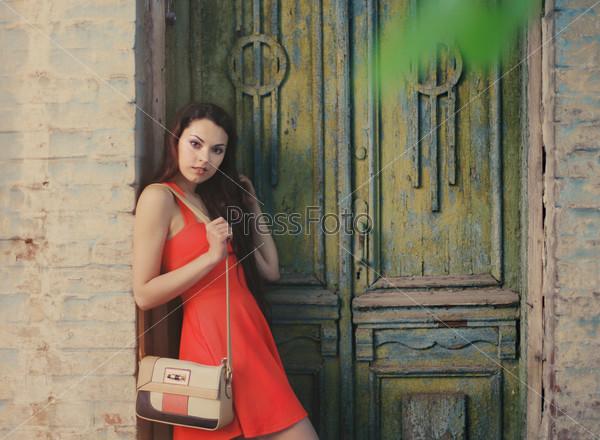 Сute girl near the old wooden door