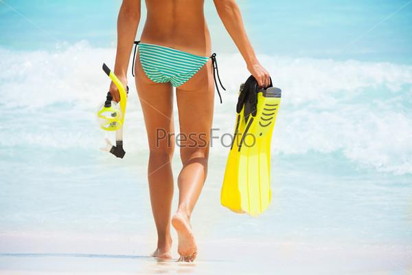Back of beautiful girls body on beach background