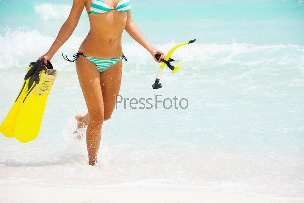 Beautiful womans body on beach background
