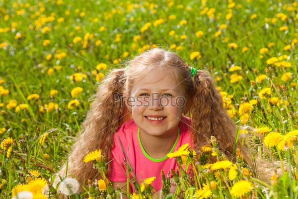 Portrait of smiling girl in the green grass