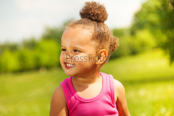 Laughing small girl on the nature background