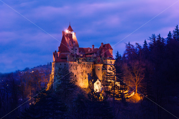 Dracula Castle with lights at night in Romania