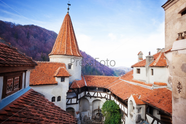 Red roofs of Bran Castle in inner yard, Romania
