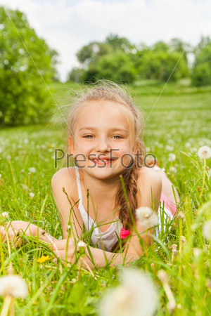 Beautiful girl laying on a meadow