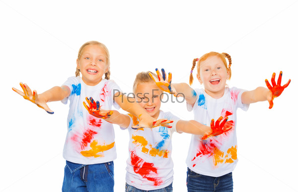 Three little girls show palms and smile