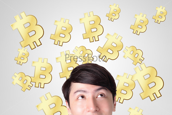young man happy looking bitcoin