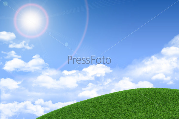 Green grassy hill. Background clouds and sun