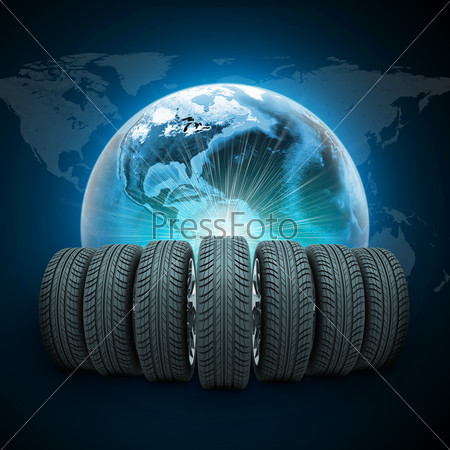 Wedge of new car wheels. Earth with light and world map