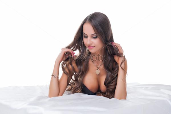 Beautiful busty woman posing shyly at camera