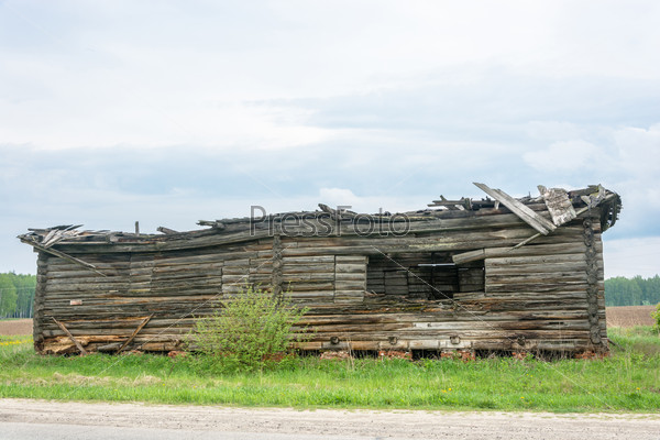 Destroyed log house.