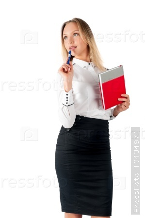 Businesswoman standing with organizer diary