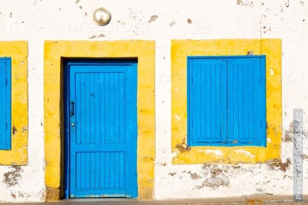 old door in morocco   yellow window