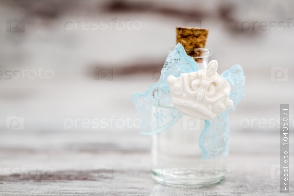 Bottle of Cologne with Blue Lace Prepared as a Gift for Baby Sho