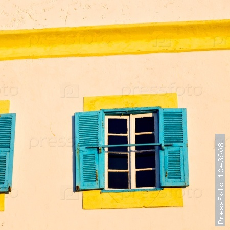 blue window in morocco africa old construction and brown wall  c