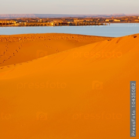 sunshine in the lake  desert of morocco sand and dune