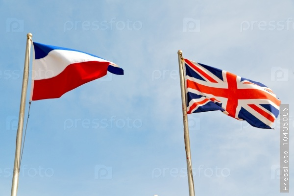 french waving flag in the blue sky
