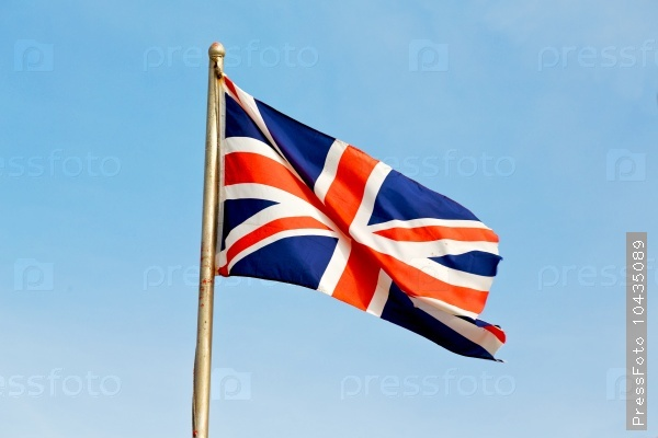waving flag in the blue sky british colour