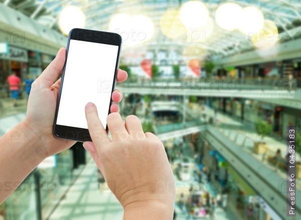 hand holding a modern smartphone in supermarket