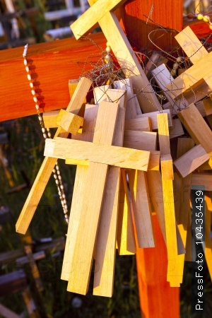 wooden crosses . Christianity