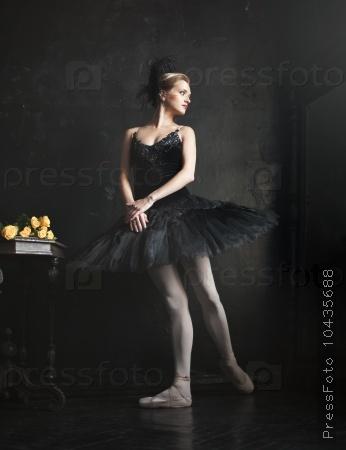 Portrait of the ballerina in ballet tatu on black background