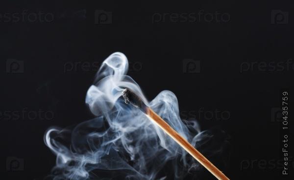 Extinguished Match On Dark