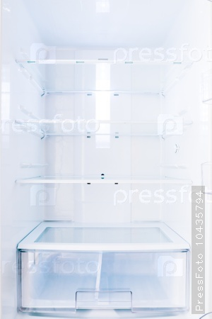 an open home based fridge with empty shelves closeup