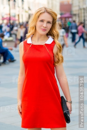 bright blonde in the city center shooting in the afternoon
