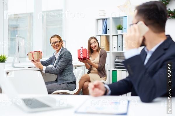 Businesswomen with presents