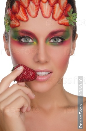 charming woman with strawberries on face and hand