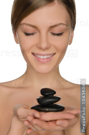 Beautiful woman holding stones in hand