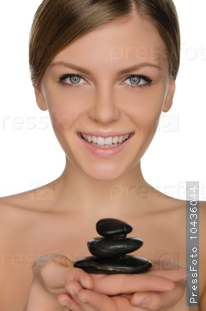 smiling woman holding stones in hand