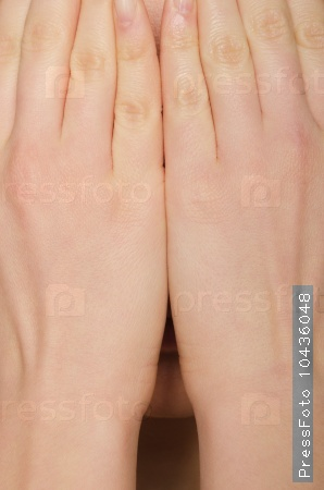 woman's face covered by hand