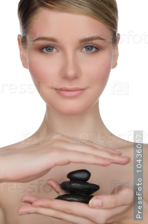 Beautiful woman holding black stones in hand
