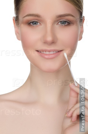 happy woman holding cotton swabs at mouth