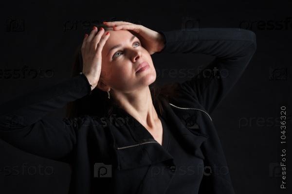 brunette woman looking up in darkness