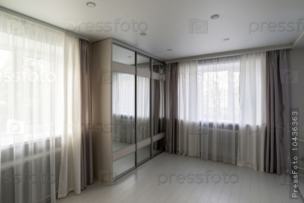 interior of living room with window and mirror wardrobe