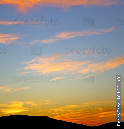 the sunrise in  colored sky white soft clouds and abstract backg