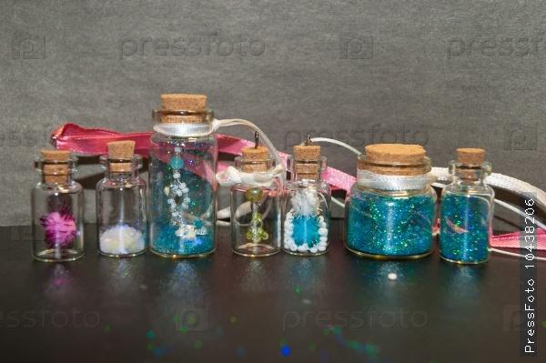 Seven sparkle bottles