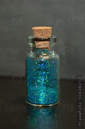 Blue sparkles in bottle