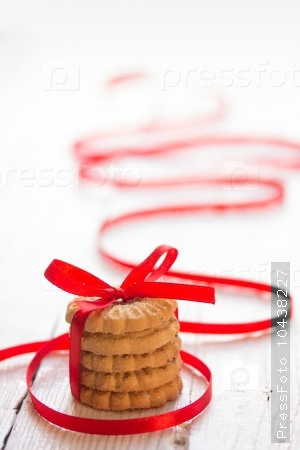 Several fresh cookies with red ribbon