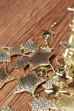 Рождественские украшения золотые звезды